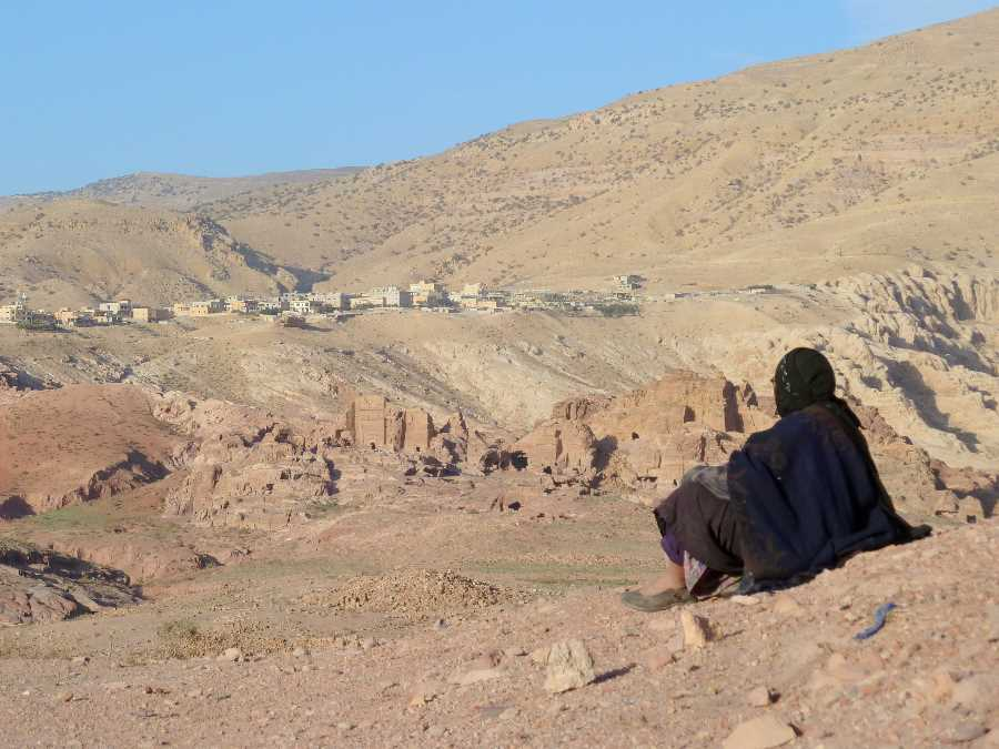 Bedouin woman looks over the Petra landscape