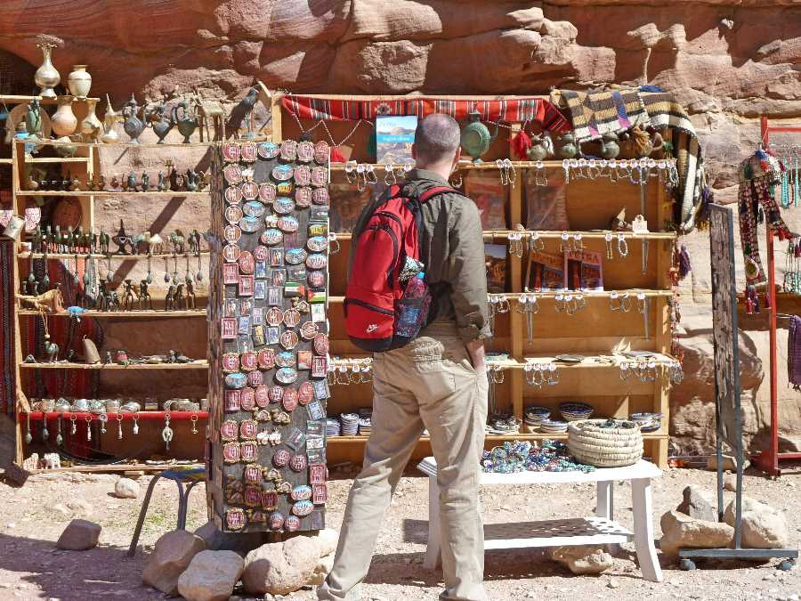 A tourist browses souvenirs at Petra