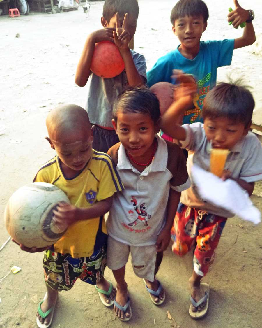 Boys pose with a football in Mandalay