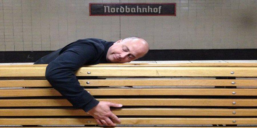 Peter hugs a bench in Berlin